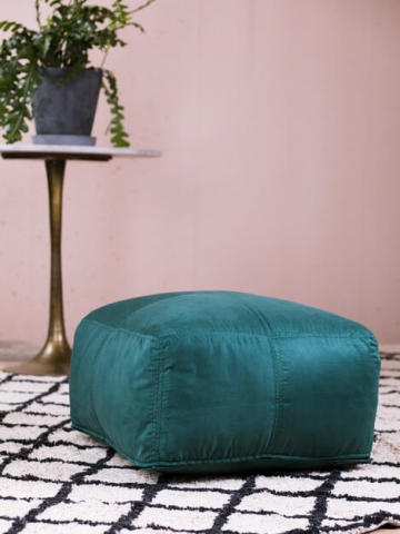 An image of a green velvet pouf