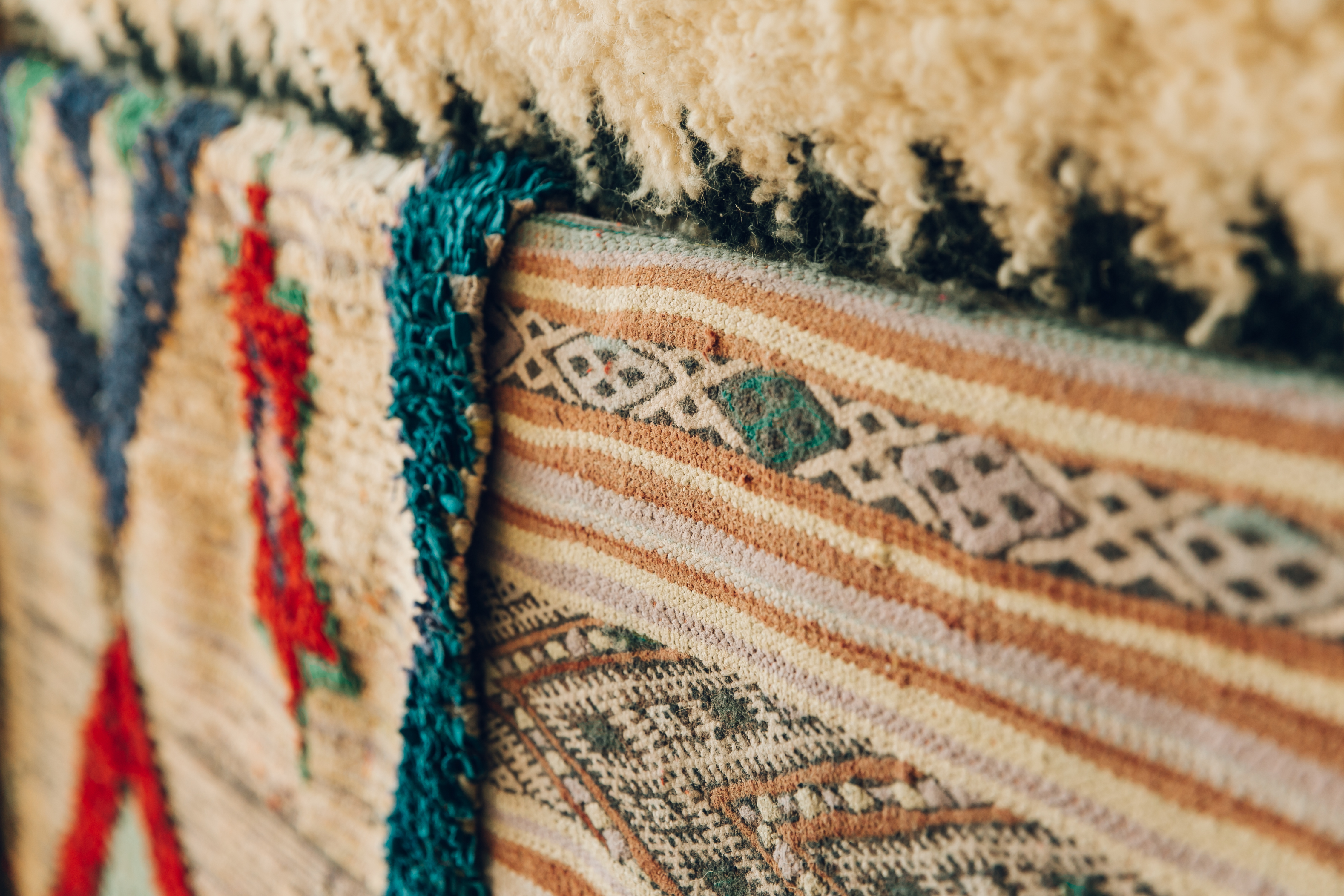 Layered Moroccan rugs add a new pattern