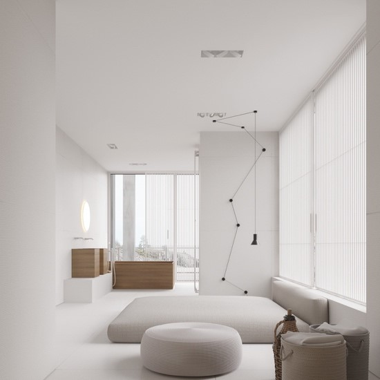 A contemporary minimalist bedroom interior featuring a statement light, neutral colours and natural materials. The room is uncluttered, with storage for small items.