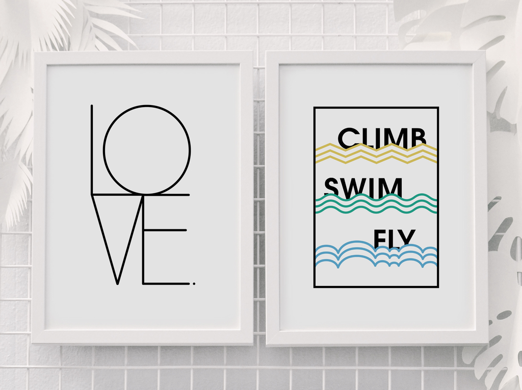 Two minimal prints, one with the word 'Love', the other with the words 'Climb, Swim, Fly'. The fonts used in both are subtle, allowing them to add interest without being too intrusive.