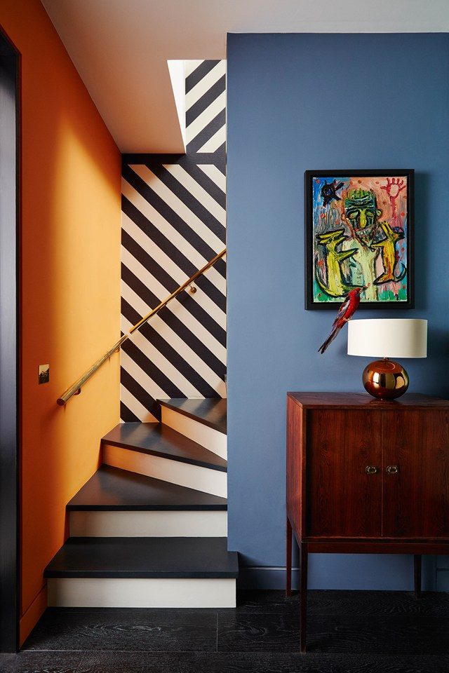 Bold painted stairs that work with a graphic style hallway scheme